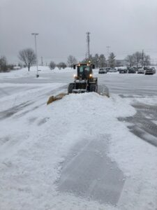 Town & Country Commercial Property Maintenance Plowing a commercial parking lot
